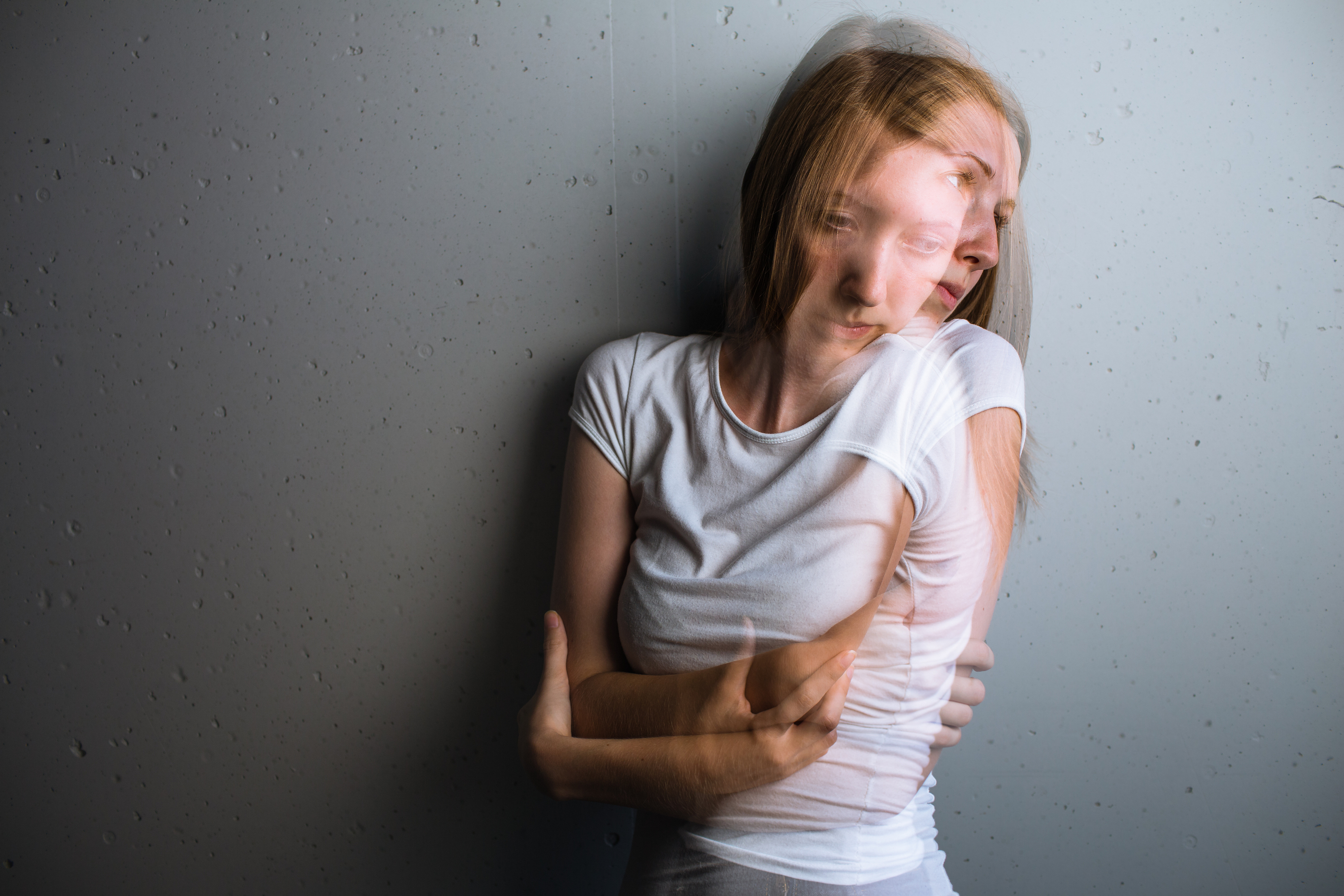 Young woman suffering from a severe depression/anxiety (color to